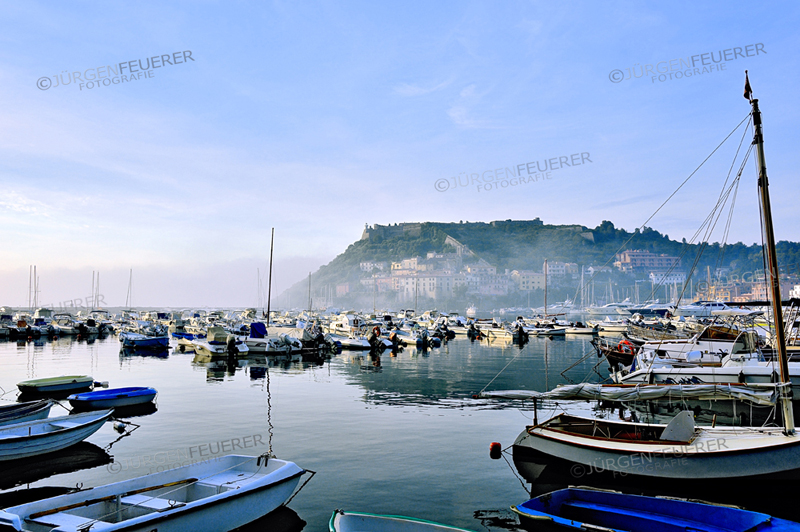 Mist in the bay of Port'Ercole in the morning, costal town of the Tuscany, Italy