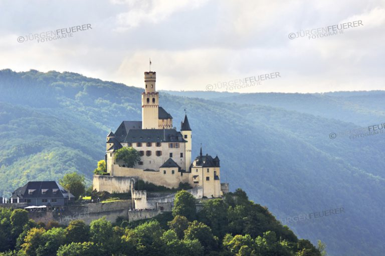 View to Marksburg with dusty light, castle above the Rhine Gorge and the town Braubach, Upper Middle Rhine Valley, Germany