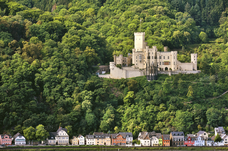 tolzenfels Castle near Koblenz and lined colored houses at the river bank of the Rhine, Upper Middle Rhine Valley, Germany