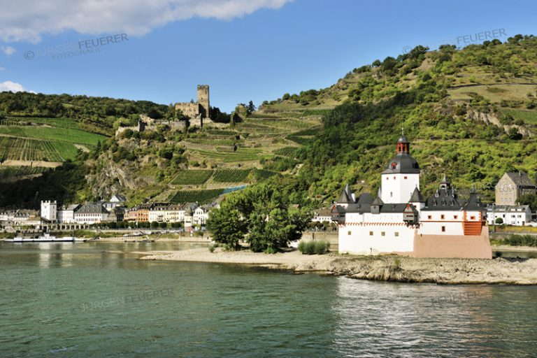 Pfalzgrafenstein Castle, toll castle in middle of the Rhine, town Kaub and Gutenfels castle in the background, Upper Middle Rhine Valley, Germany